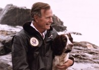P24216-05A President Bush with his Springer Spaniel, Ranger, on the rocks outside their home on Walker's Point, Kennebunkport, ME, 10 Aug 91. Photo Credit: George Bush Presidential Library and Museum